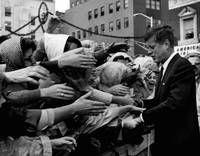 President John F. Kennedy shaking hands