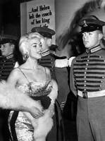 Jayne Mansfield in front of guards