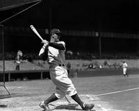 Lou Gehrig driving the ball deep