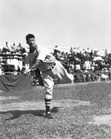 Lefty Grove pitching in front of crowd