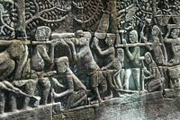 Wall carving of Temple workers AngkorWat Cambodia