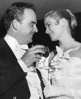 Grace Kelly toasts with husband