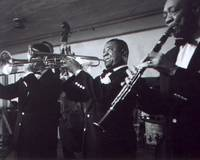 Louis Armstrong playing with the band