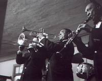 Louis Armstrong playing the trumpet with band