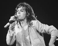 Mick Jagger leans into the microphone