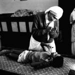 """Mother Teresa helping boy"" by RetroImagesArchive"