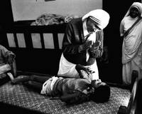Mother Teresa helping boy