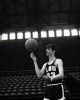 Pete Maravich spinning ball on finger