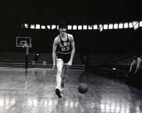 Pete Maravich dribbling between legs
