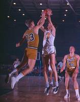Pete Maravich shooting over player