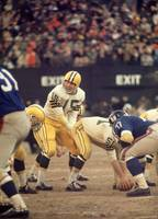 Bart Starr calls out the snap