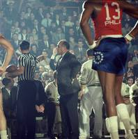 Red Auerbach talks with ref