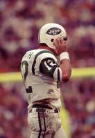 Joe Namath fixing helmet
