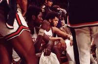 Kareem Abdul Jabbar with team on bench