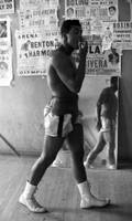 Muhammad Ali walking in gym