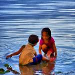 """Children playing in water"" by who"