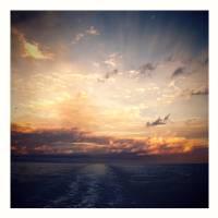 Sunset over ocean Art Prints & Posters by Robert Cattan