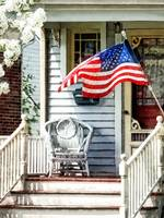 Porch With Flag and Wicker Chair