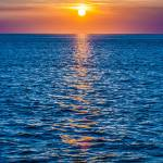 """sunset at sea with multiple color prizm"" by digidreamgrafix"