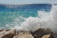 Big wave on the beach. Podgora, Croatia