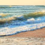 """""""Morning waves roll onto the beach"""" by RoupenBaker"""