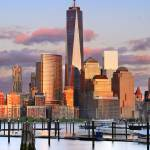 """Freedom Tower & Manhattan skyline at sunset"" by emporoslight"
