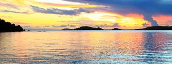 Tropical Sunset Sky over Shinning Seas Panorama