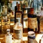 """Medicine Bottles in Glass Case"" by susansartgallery"