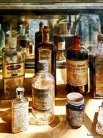 Medicine Bottles in Glass Case