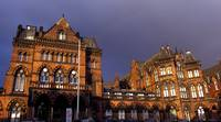 Victorian Gothic Hospital with Rainbow Behind