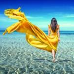 """girl in a yellow dress in sea"" by andriy_petrenko"
