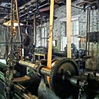 Large Lathe in Machine Shop Art Prints & Posters by Susan Savad