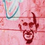 """Ghandi_Wall Graffiti in Jerusalem, Israel"" by PetraClouth"