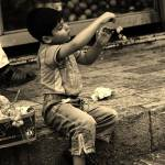 """Young Boy Playing with Grapes, Jerusalem"" by PetraClouth"