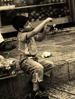 Young Boy Playing with Grapes, Jerusalem