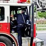 """""""Fireman Climbing into Fire Truck"""" by susansartgallery"""