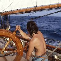 Mark at the Wheel Under Sail by Bil McAllen for Im Art Prints & Posters by Bill McAllen