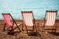 Stripy Deckchairs Pebble Beach Sea and Sunshine