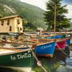 """Small Boats in a Harbor at Lake Garda"" by George_Oze"