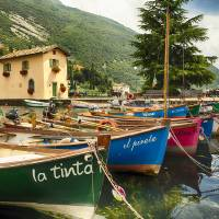 Small Boats in a Harbor at Lake Garda Art Prints & Posters by George Oze