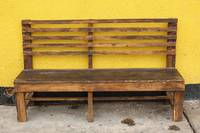 Wood Bench Next to a Yellow Wall