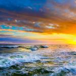 """Red sunset panorama red ocean sunset with waves"" by eszra"