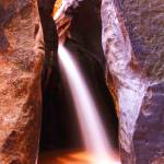 """Slot Canyon Waterfall"" by RoupenBaker"