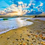 """Blue Beach Sunset with Amazing Sun Rays"" by eszra"
