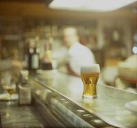 Glass of beer in Spanish tapas bar square