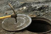 Pick Axe in a Man Hole Cover