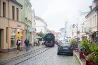 Train Traveling on Cobblestone