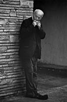 1968--Old Man Playing Harmonica