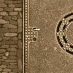 """manhole cover and brickwork freiburg germany"" by jnanian"
