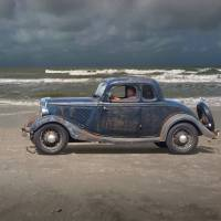 1934 Ford Coupe On The Beach Art Prints & Posters by Ron Long